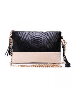 two colored leather clutch in real leader. wrist strap and shoulder strap.